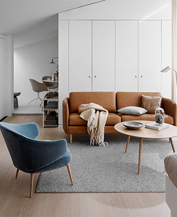 Brown leather sofa and blue armchair