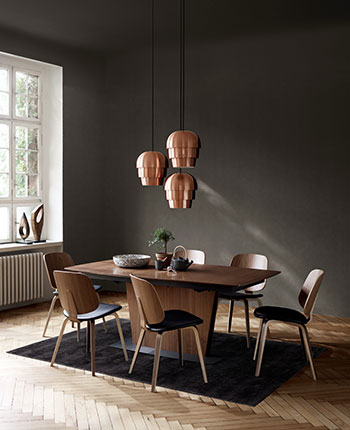 Milano dining table in walnut veneer and Aarhus chair in walnut veneer with copper Pine Cone pendants