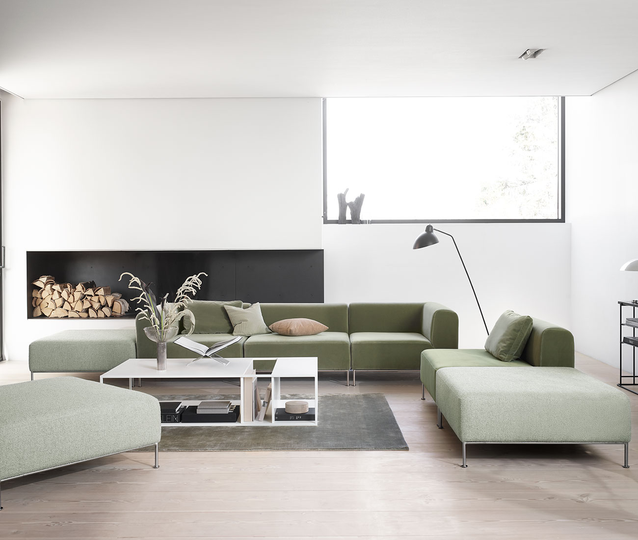 Livingroom with green sofas and white table