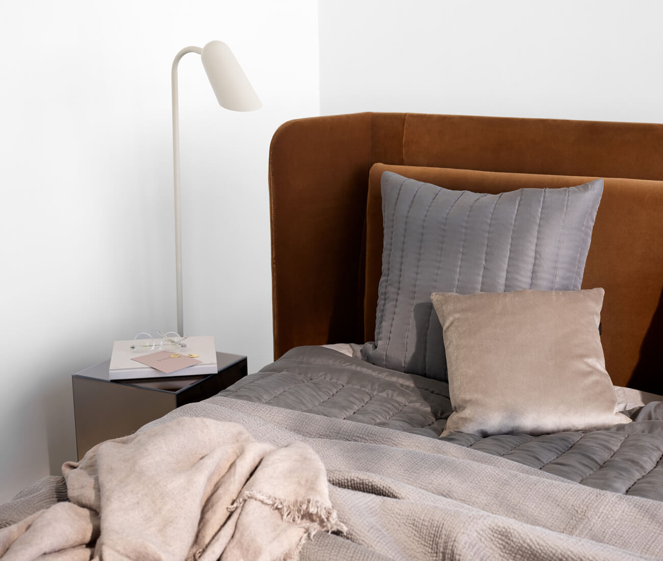 The Austin bed with sheets in nude colors