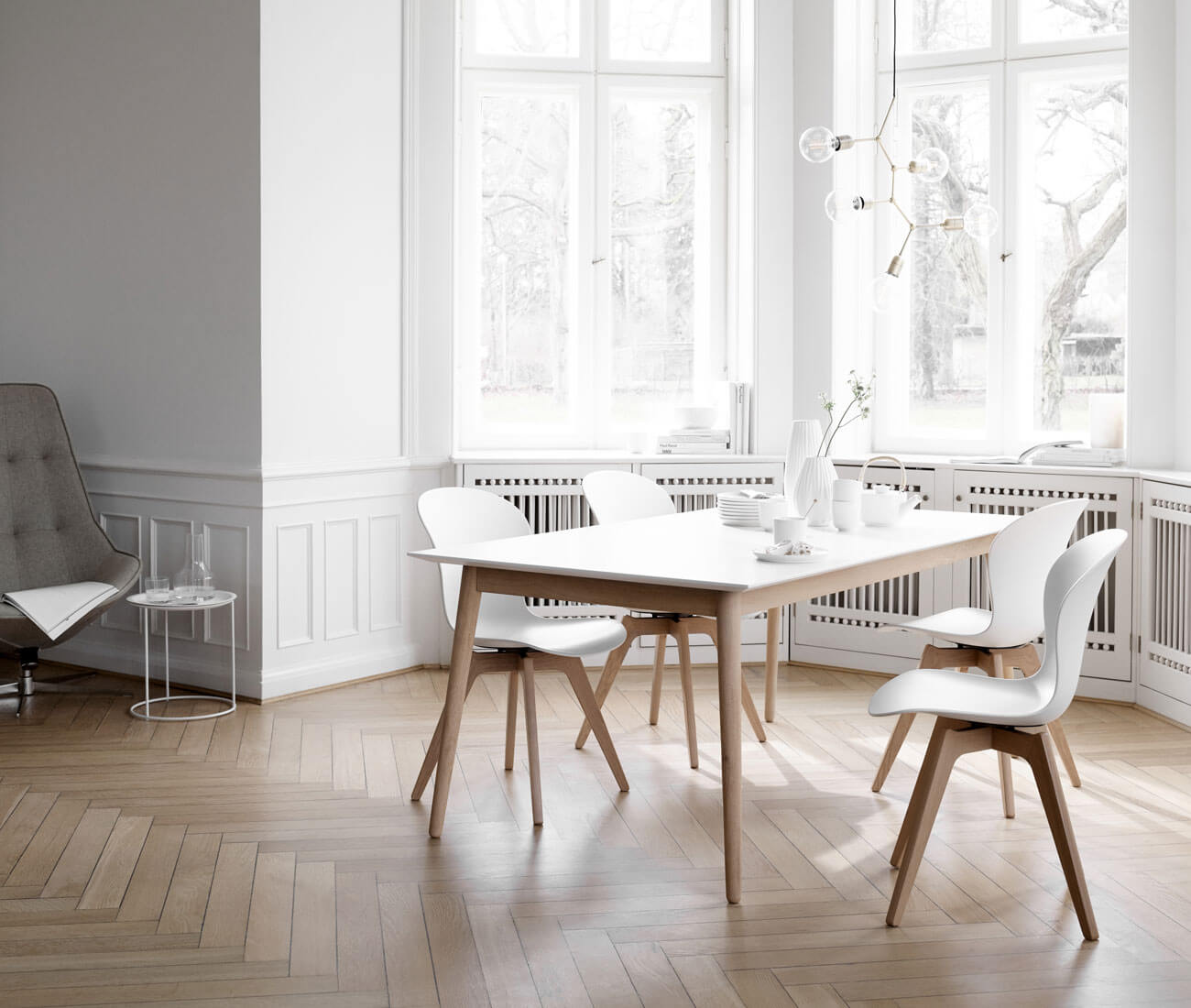 Living room with light dining furniture. Milano dining table with white table top.