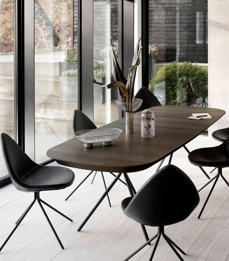 Black Ottawa chairs with a dark brown dining table