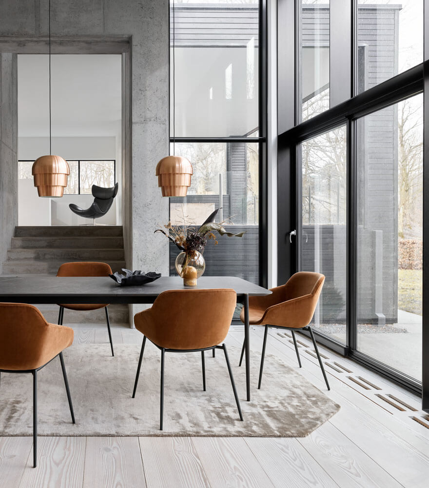 Dining room with dark marble ceramic top dining table and brown velvet dining chairs