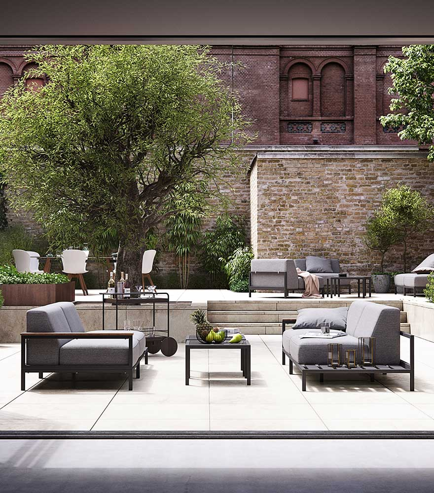 Outdoor lounge sofa in grey with black lounge tables