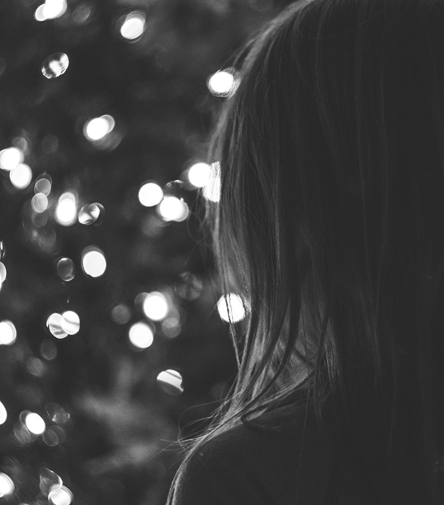 Girl and Christmas lights