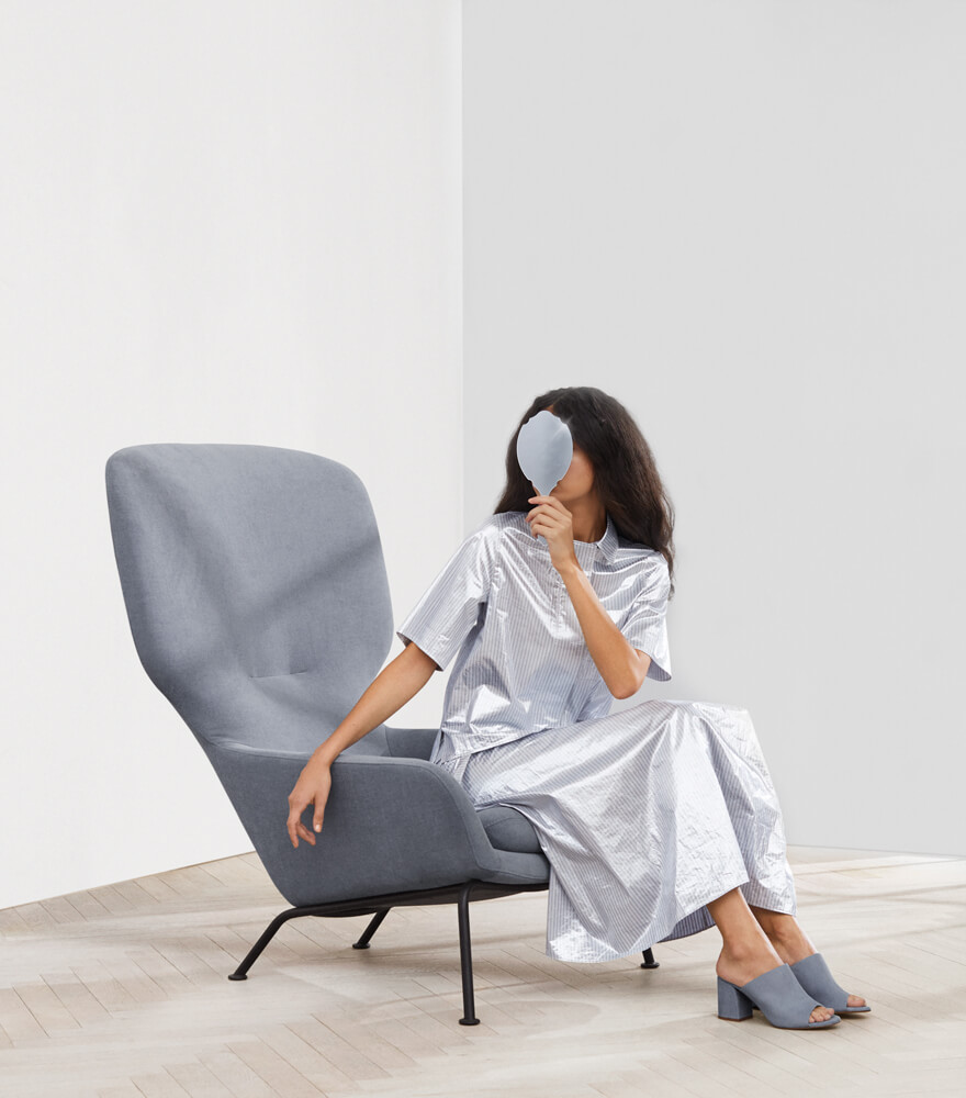 Woman holding a mirror in the Dublin arm chair