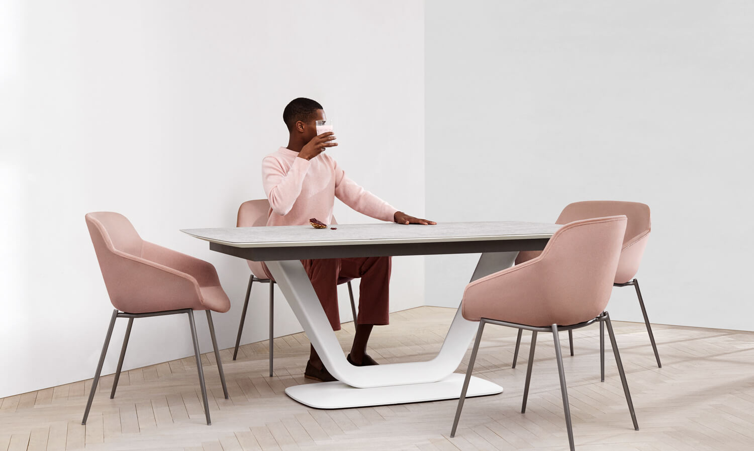 Man sitting by the Alicante dining table with Vienna dining chairs