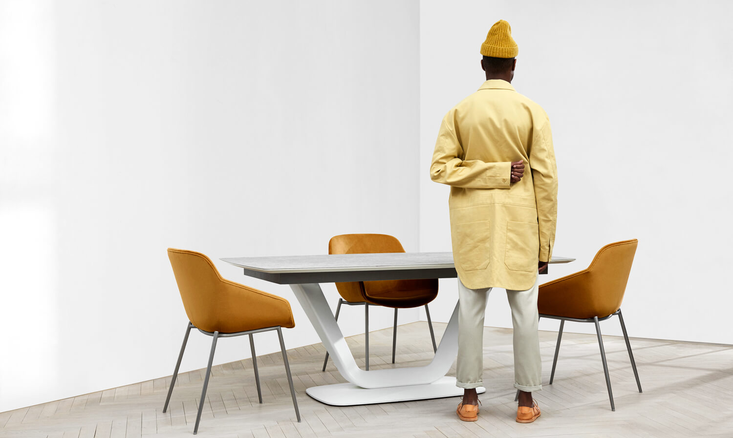 Man standing by the Alicante dining table with Vienna dining chairs
