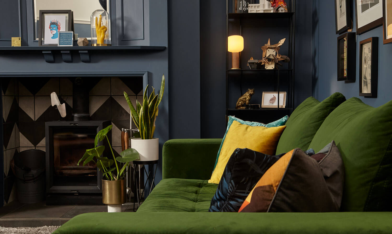 Living room with blue walls and green sofa