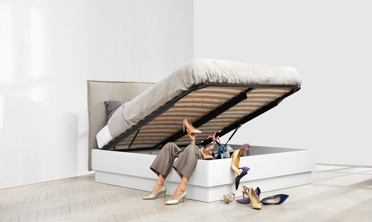 Lugano storage bed filled with stilettos