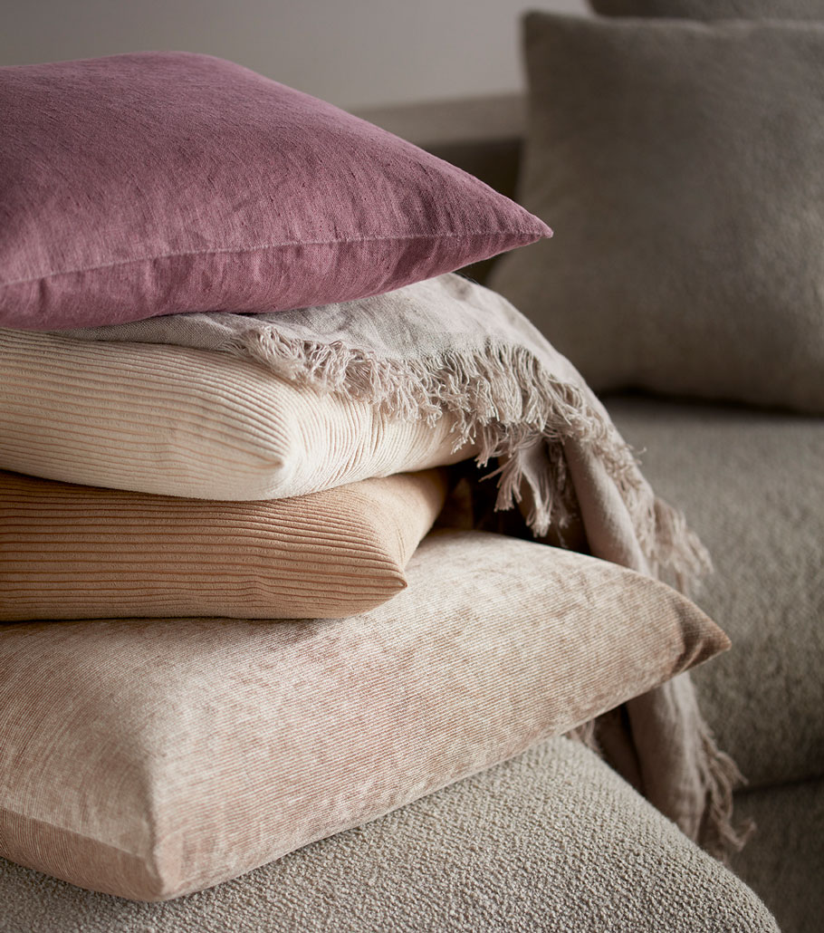 Beige and purple cushions in velvet and other fabrics