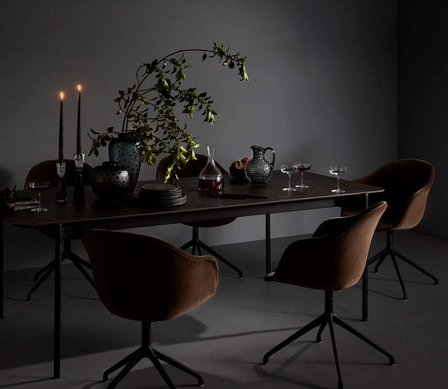 Brown chairs with black table and inspirational table setting