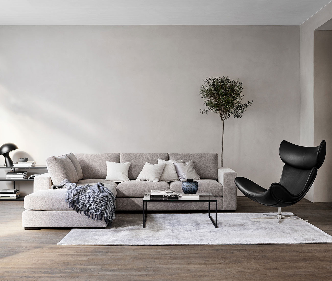 Grey sofa and black leather Imola chair