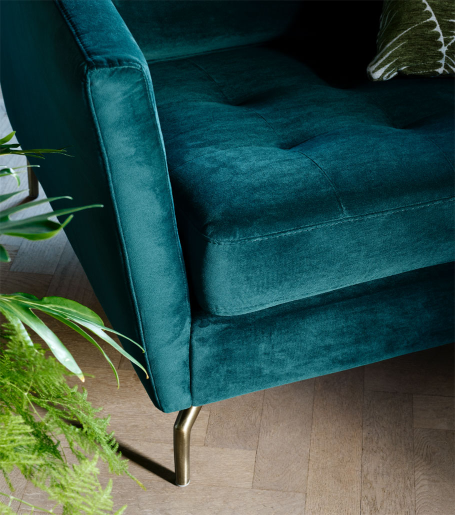 Blue velvet sofa with golden legs