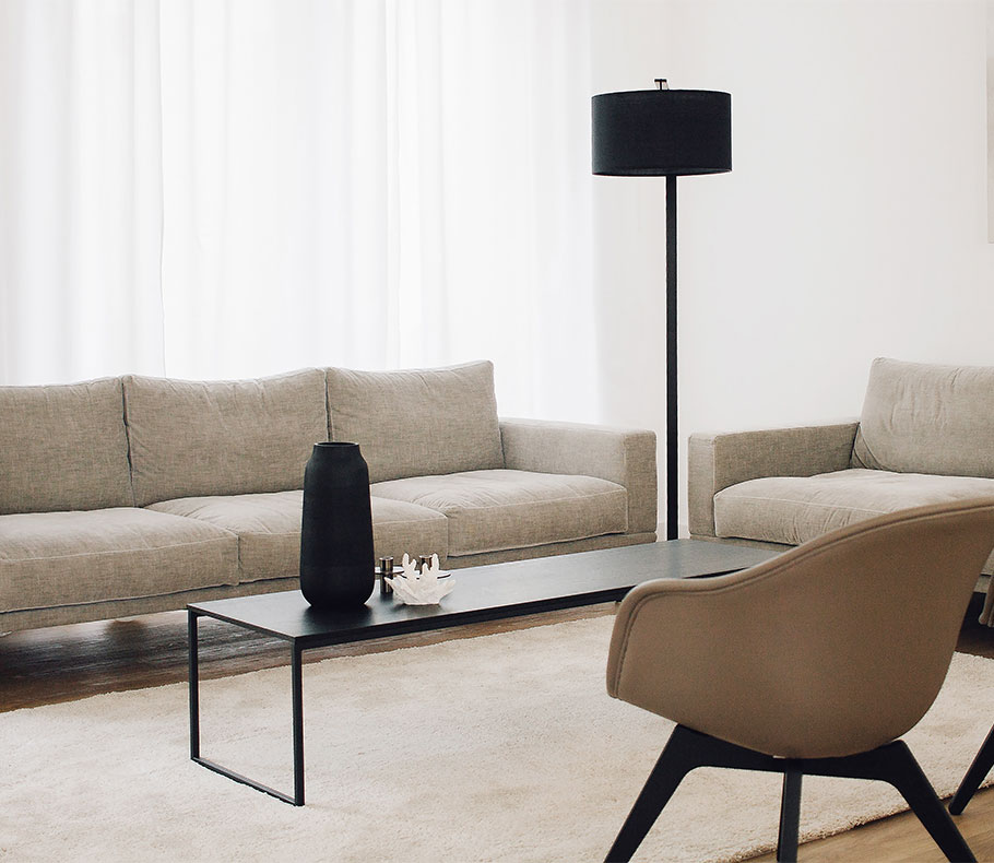 Grey sofa and black floorlamp and coffee table