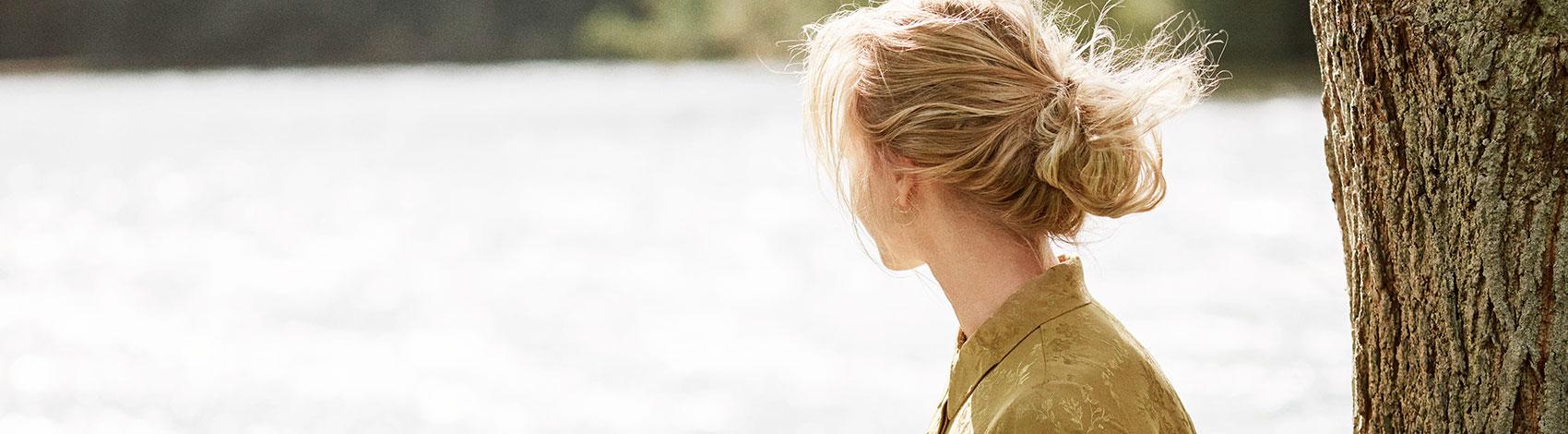 Blond girl in golden dress