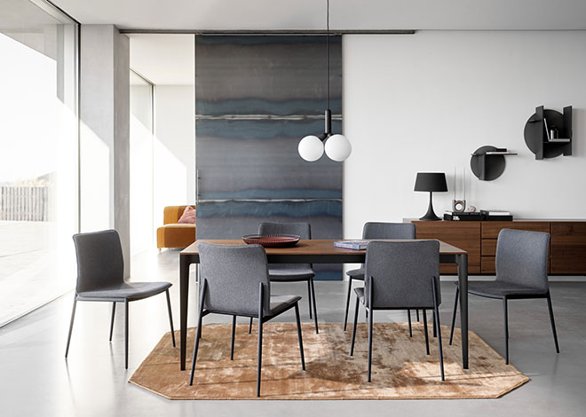 Wooden dining table with grey fabric dining tables