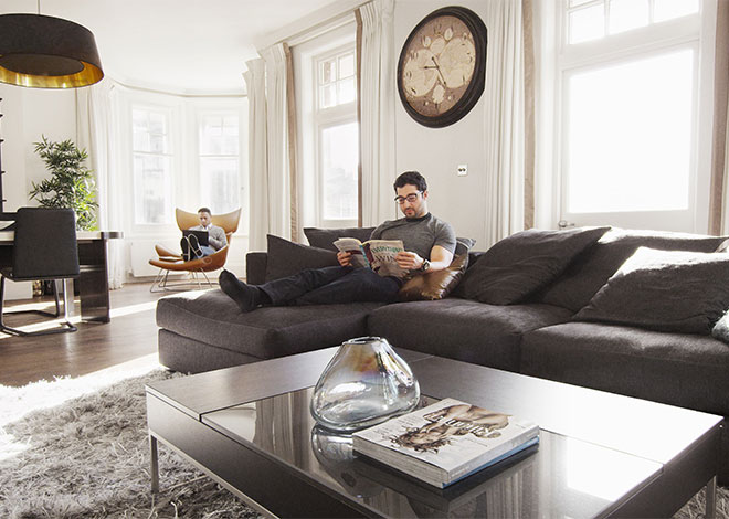 Grey couch and black coffee table