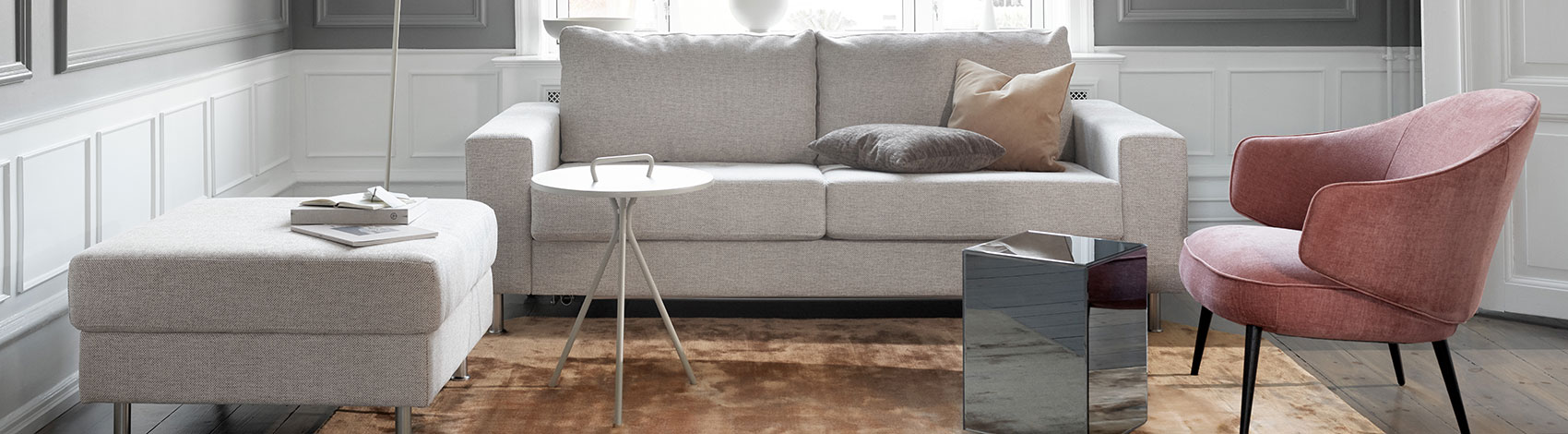 Light grey Indivi sofa with footstool and rose Charlotte armchair