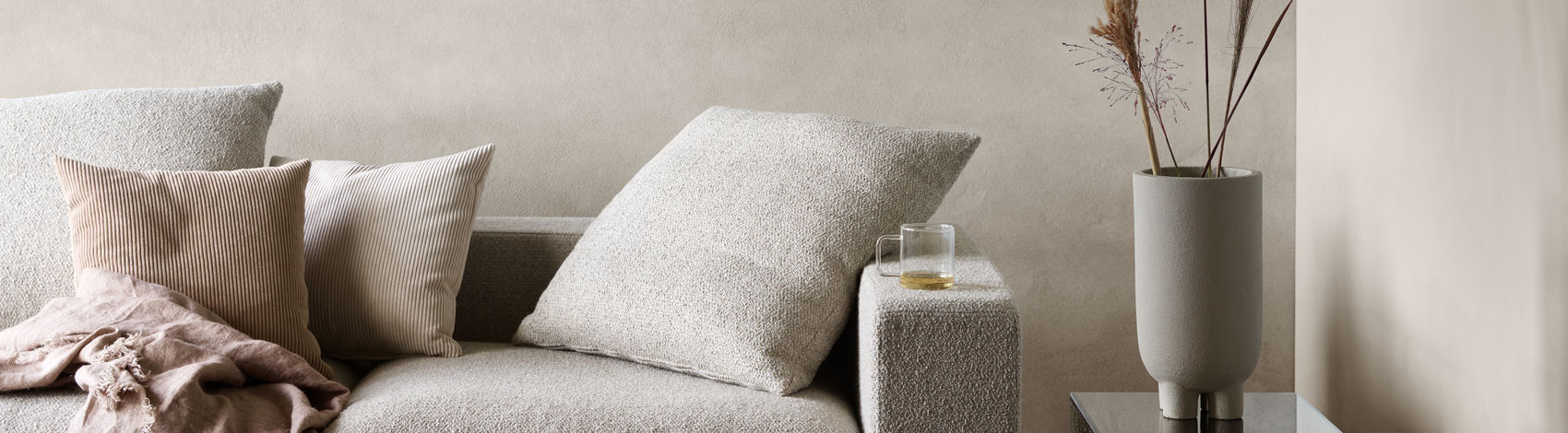 Cenova sofa with cushions and blankets