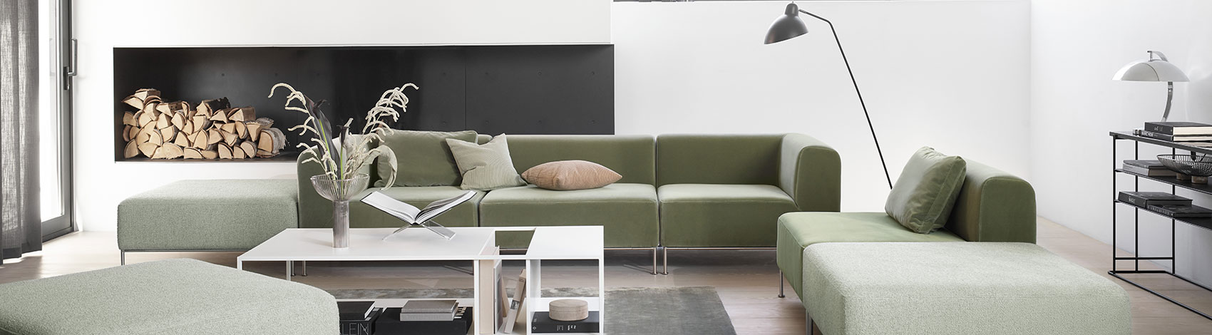Living room with green sofas and white sofa table