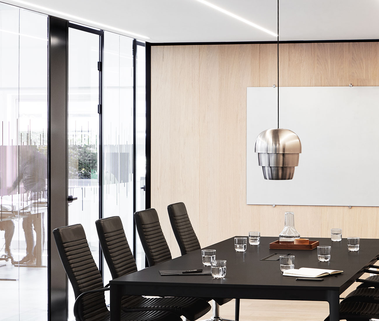 Black Torino conference table with black chairs and silver Pine Cone Lamp