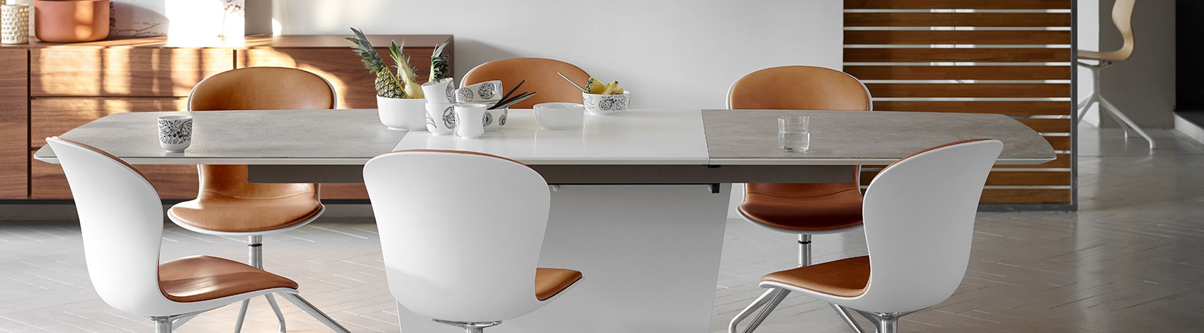 Milano table with Adelaide chairs with white shell and camel brown leather upholstery and swivel function