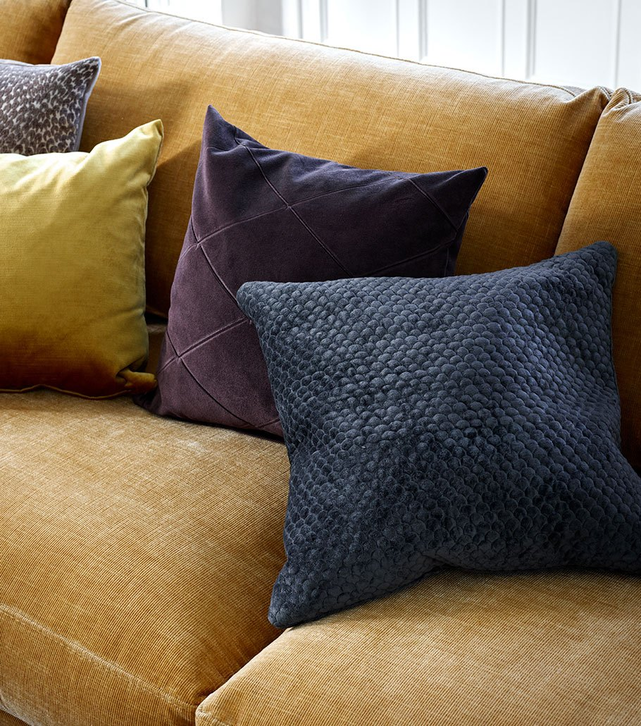 Carlton sofa in golden beige with grey, blue and purple cushions
