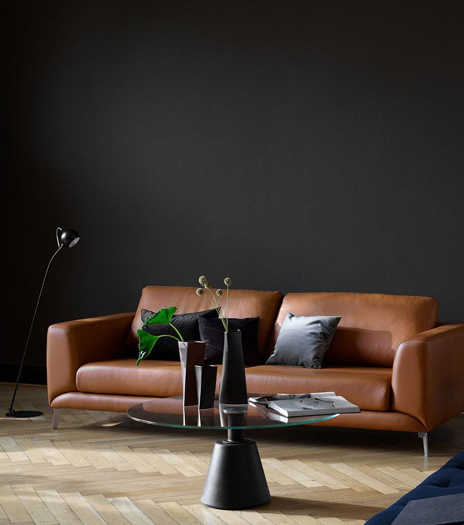 Fargo camel leather sofa and Madrid coffee table with glass tabletop and black leg