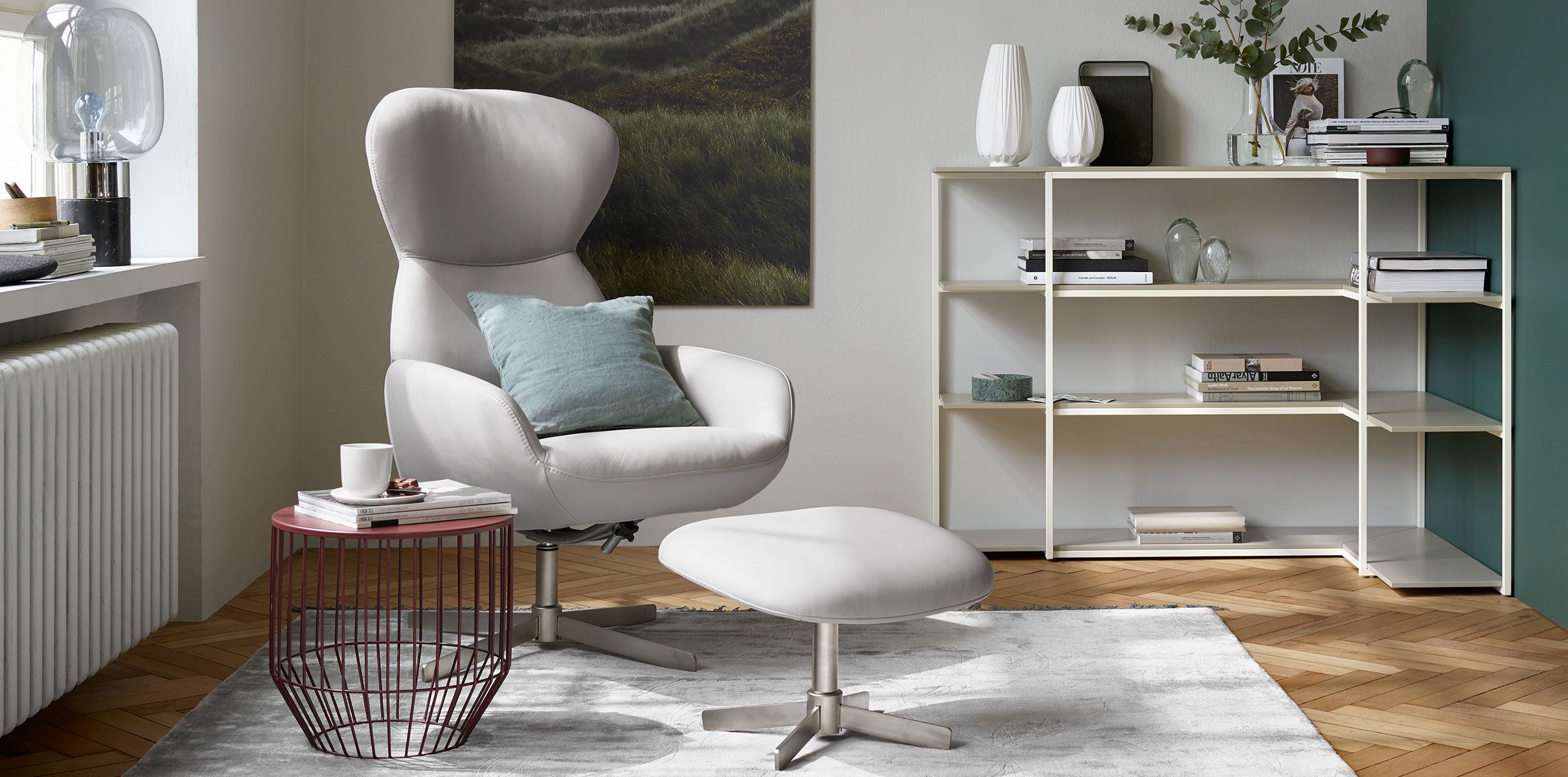 Athena chair and footstool in light fabrics with white corner bookcase