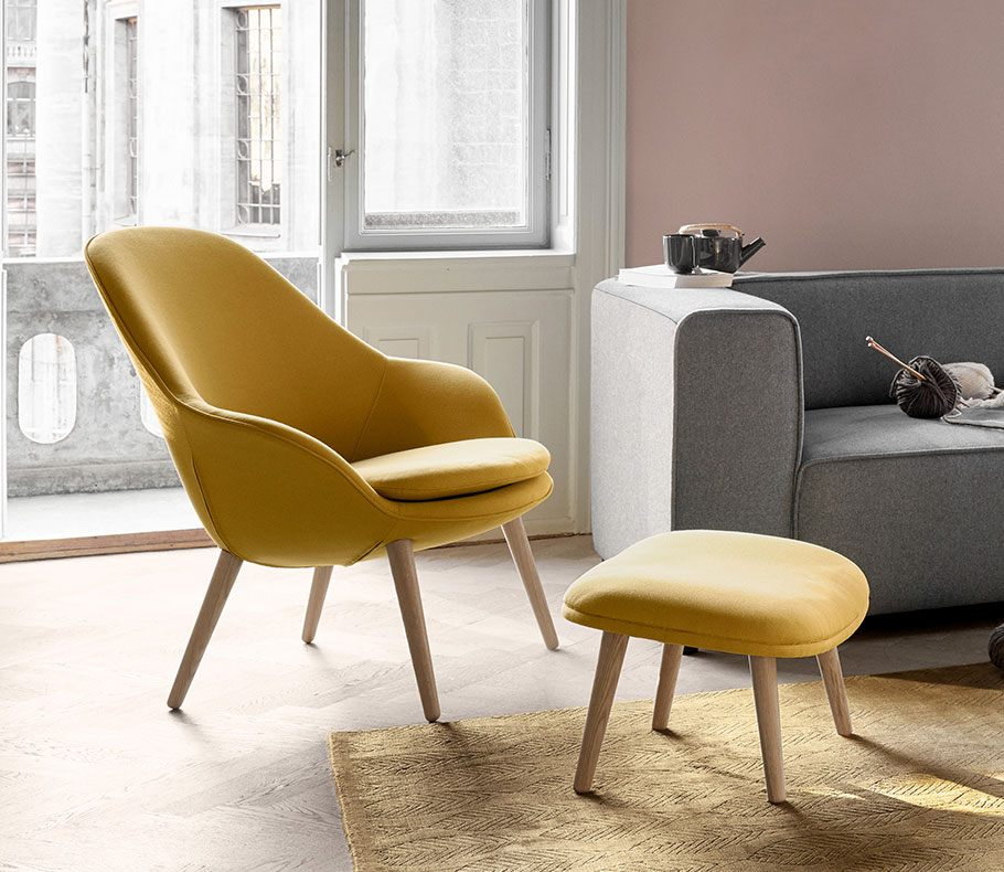 Adelaide living chair and matching footstool in yellow with oak legs and