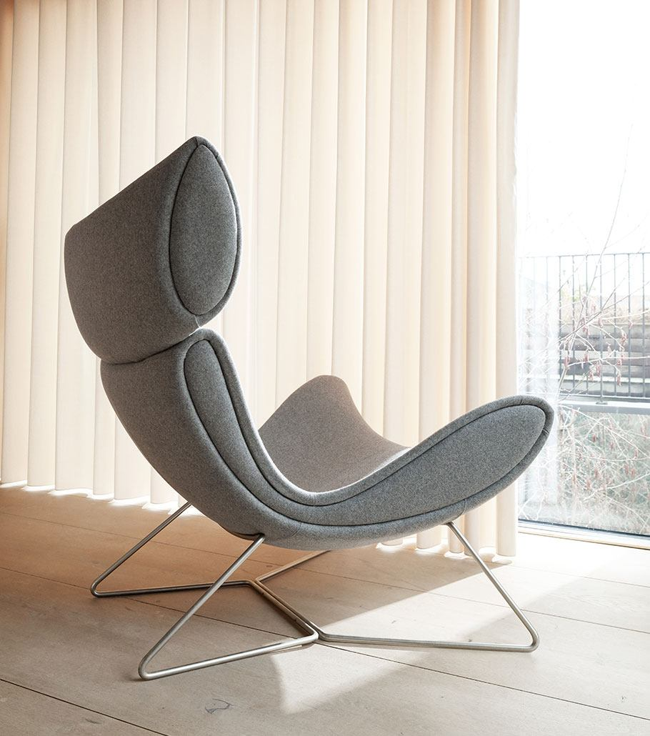 Grey Imola chair with brushed steel legs
