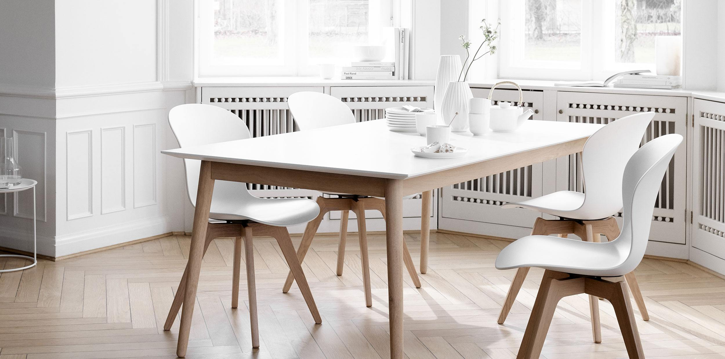White Milano table with oak legs wtih matching Adelaide chairs