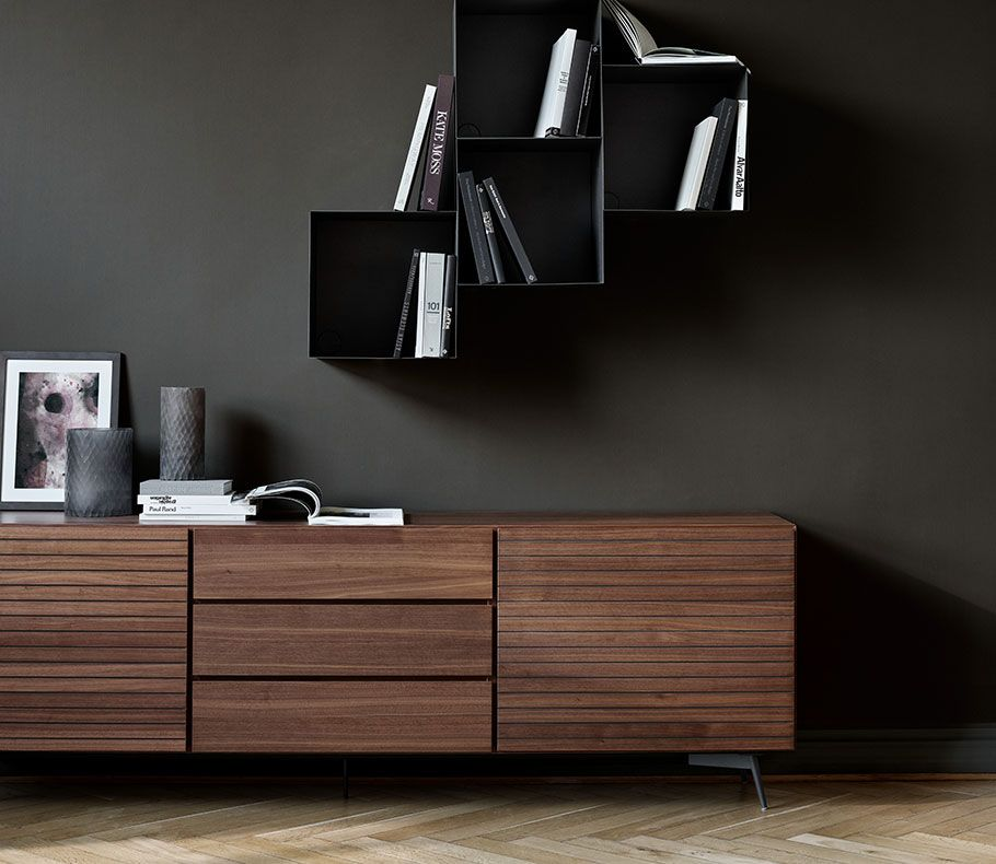 Lugano sideboard in walnut veneer with dark marble and a black wall system