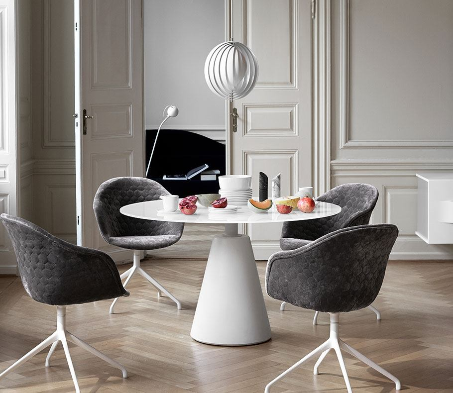 White Madrid dining table and Adelaide dining chairs in grey velvet quilt with white swivel legs