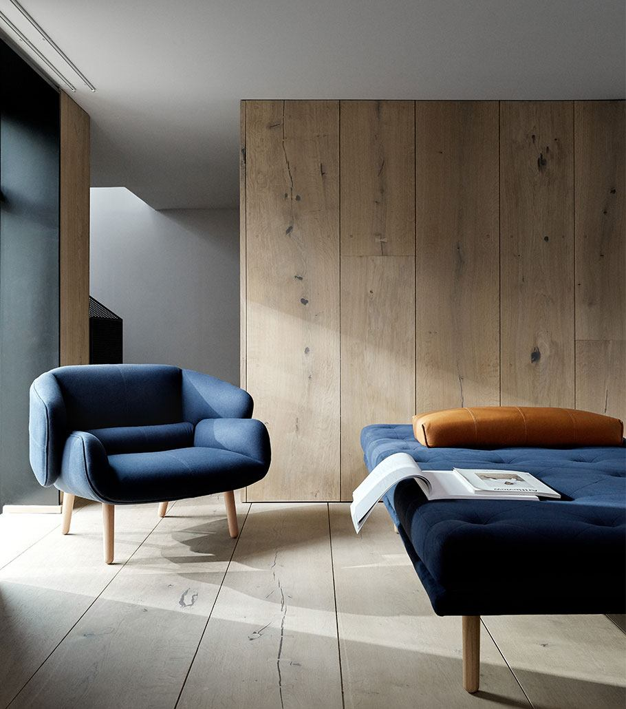 Blue Fusion armchair with oak legs and a matching Fusion daybed