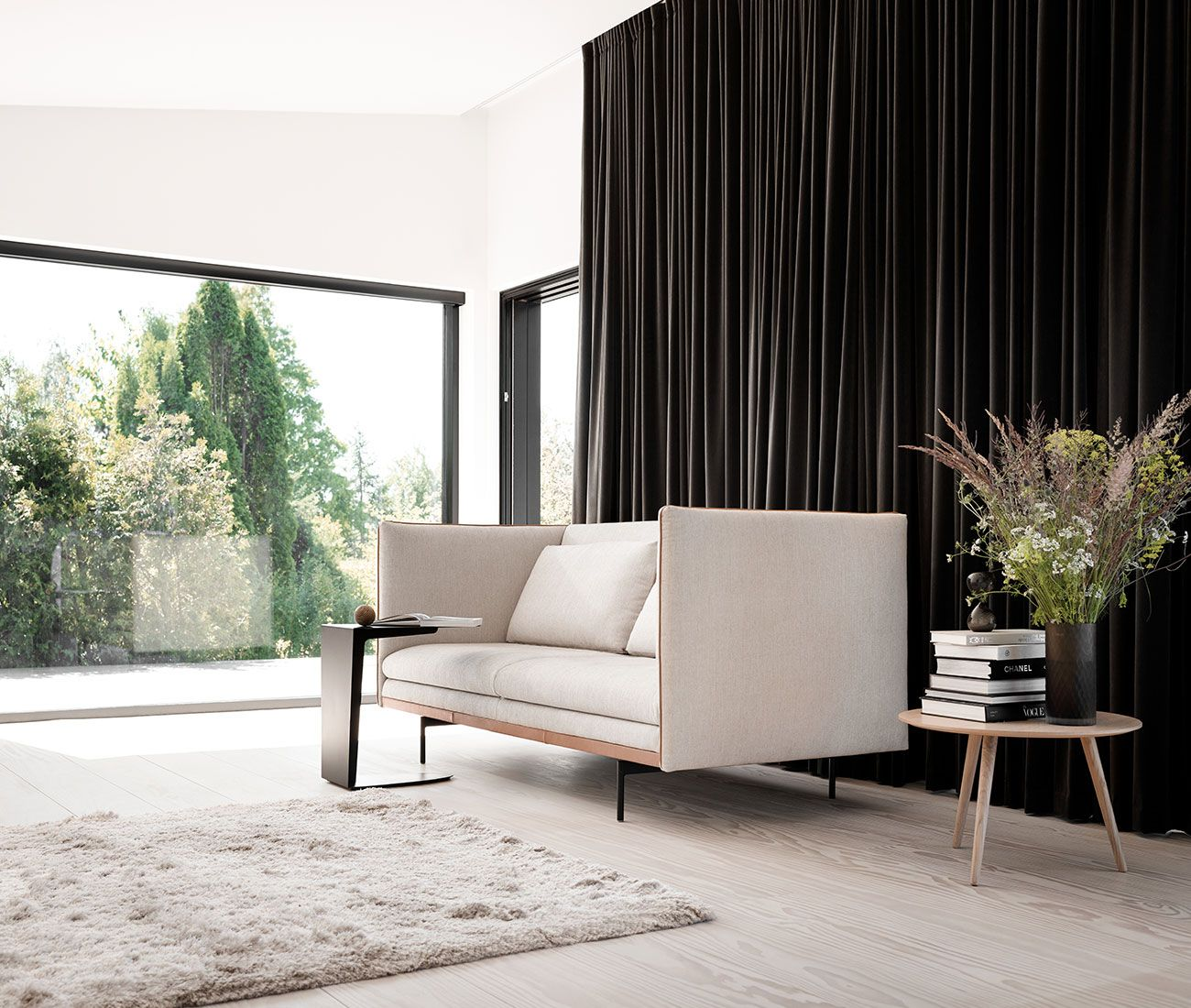 Beige sofa and rug and Ottawa side table in black