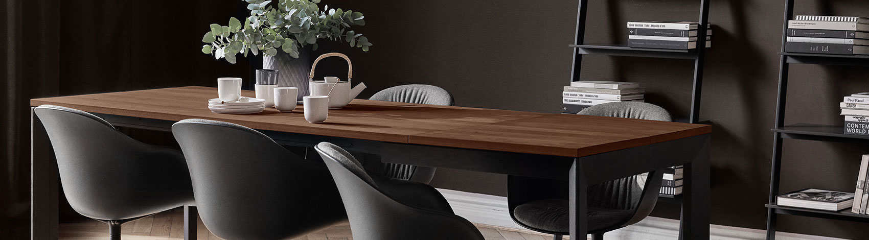 Torino table with walnut veneer tabletop and black legs with matching black chairs and black wall systems