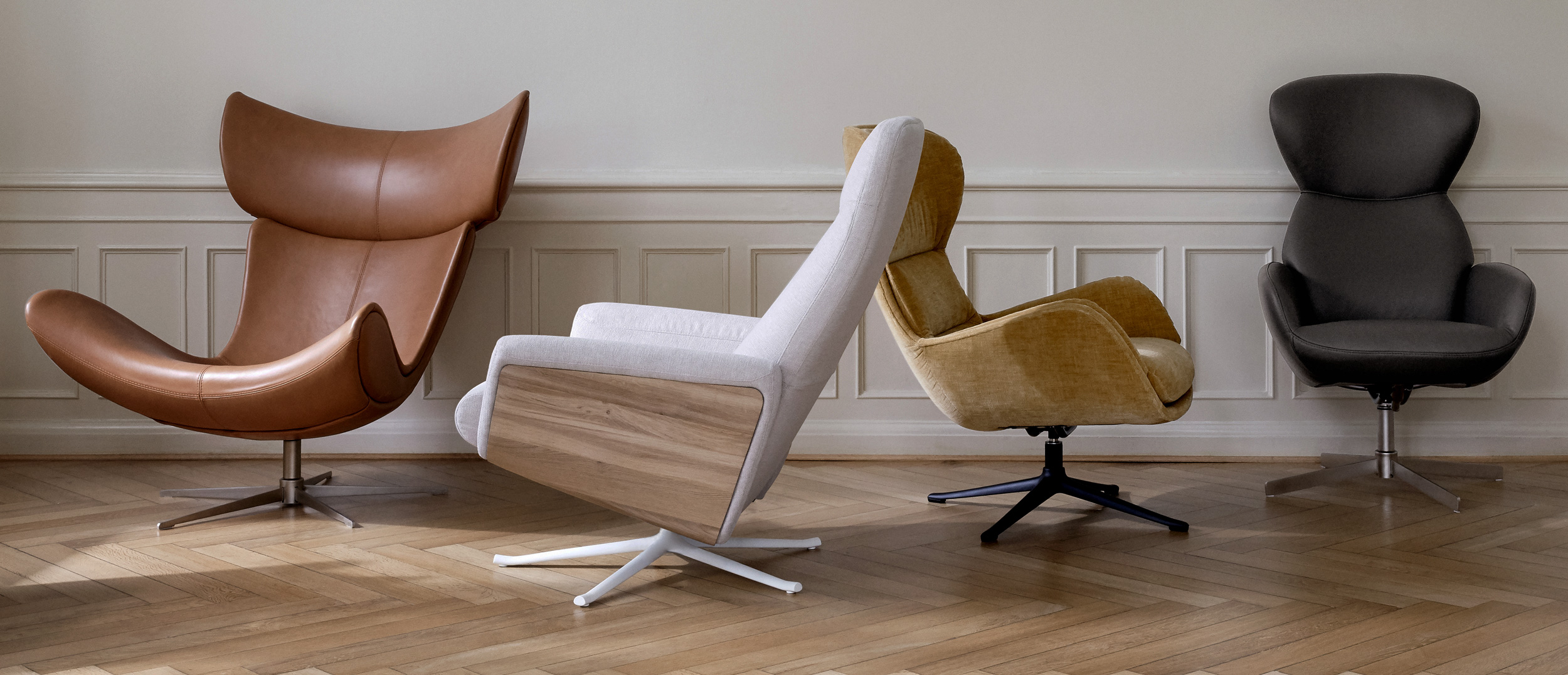 Living chairs in different leather and fabrics