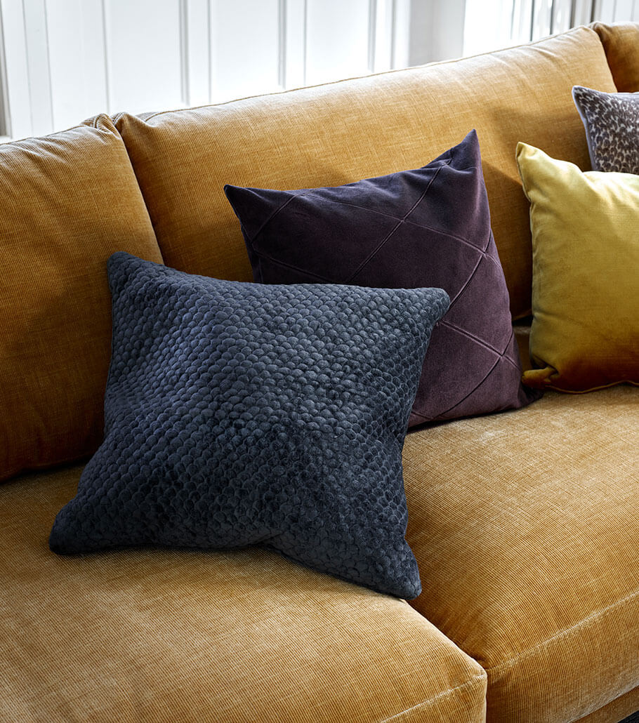 Blue, purple and yellow cushions