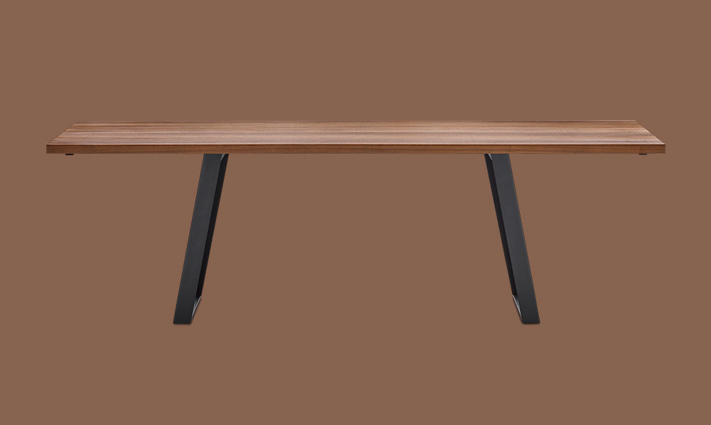 Dining table in walnut veneer and black legs