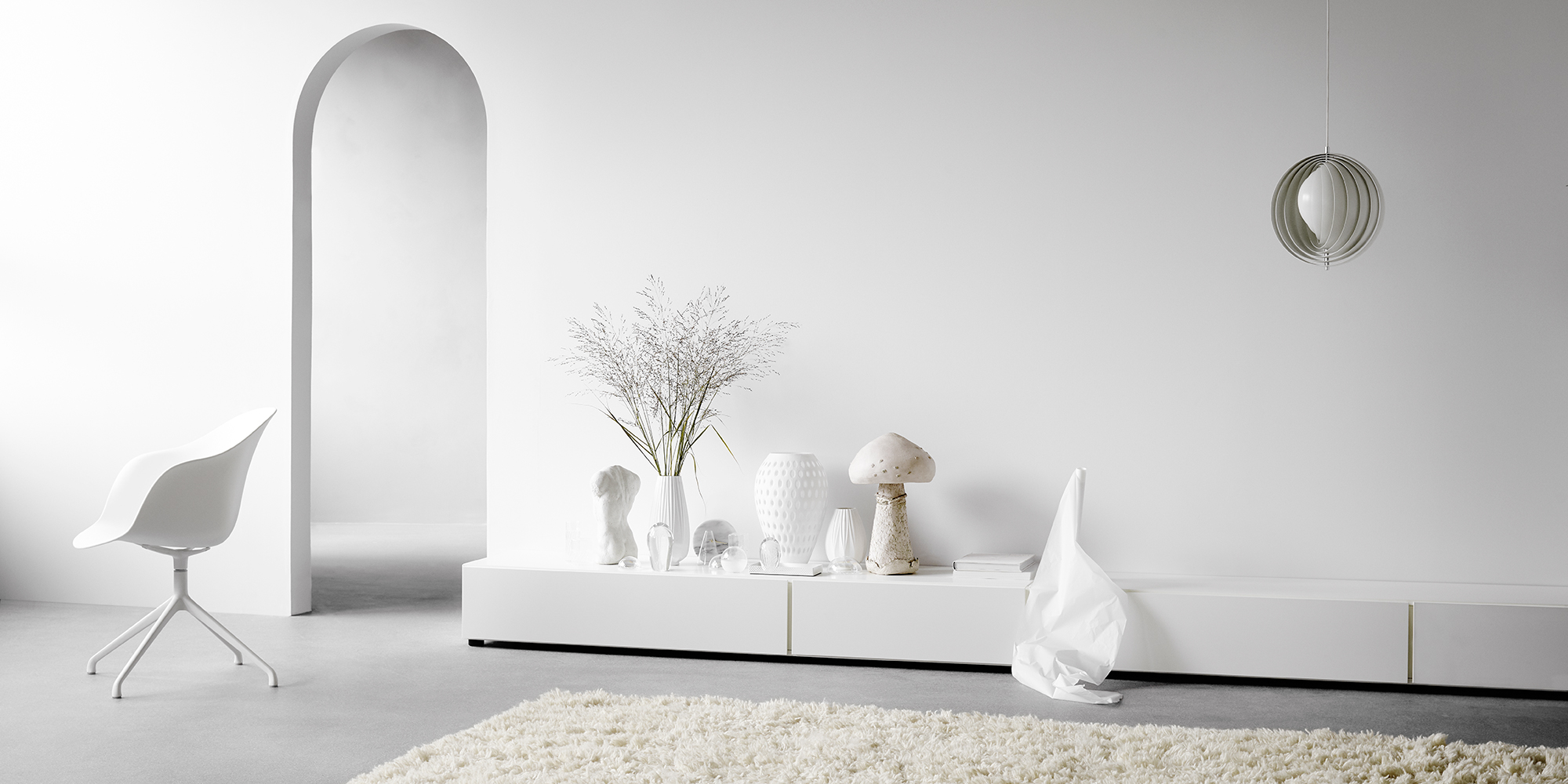 White base cabinets and white vases