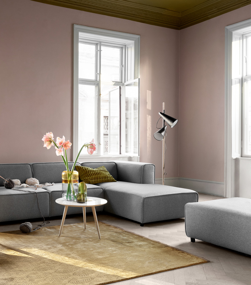 Living room inspiration with light grey sofa and pouf with beige rug