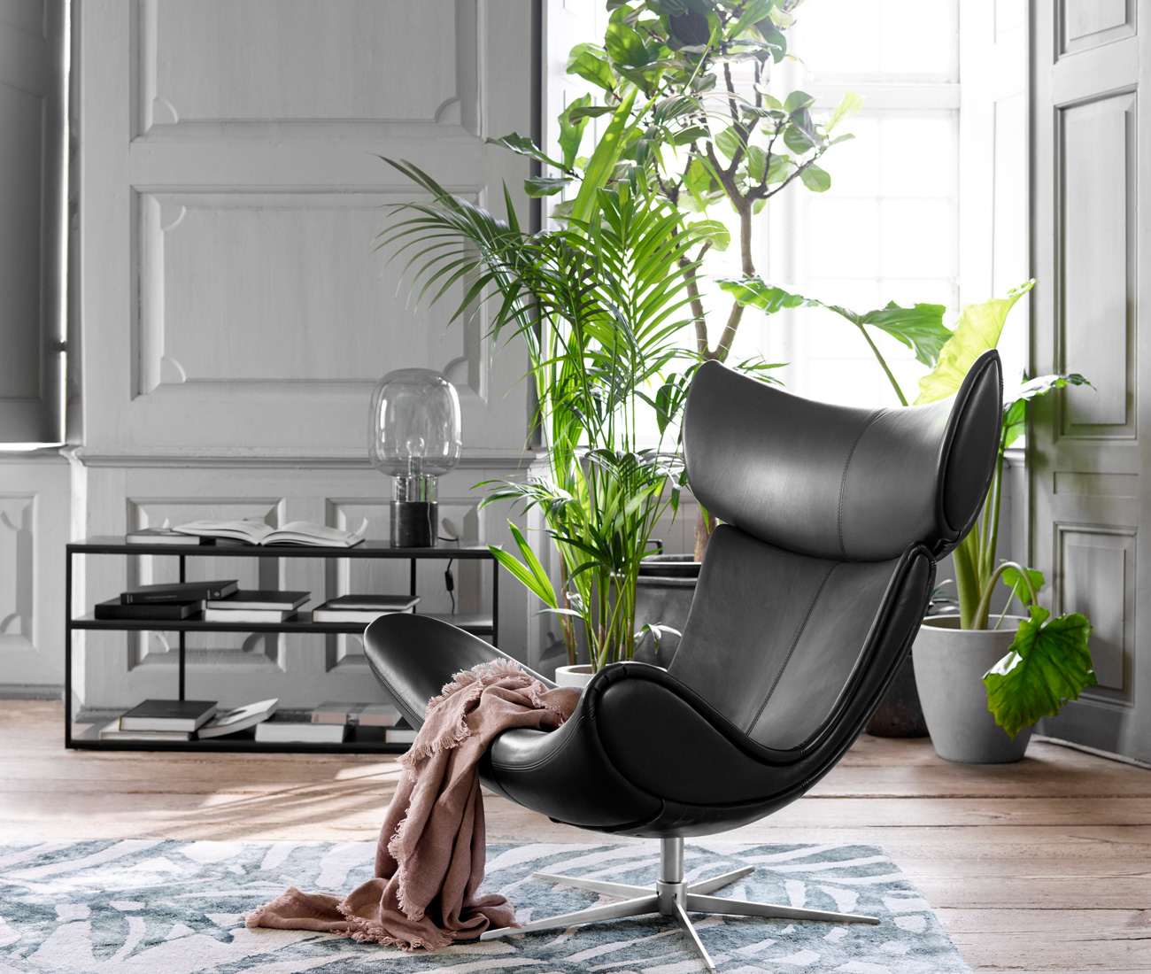 Black Imola chair in living room with plants in the background