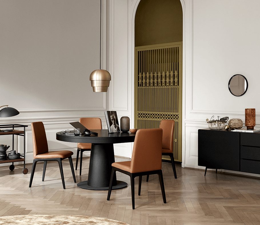 Black round dining table and brown dining chairs