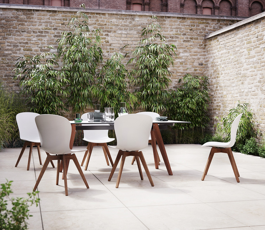 White outdoor dining chairs and table