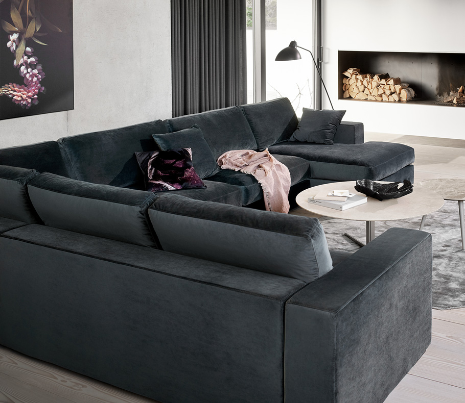Dark grey Cenova corner sofa with light grey rug and white coffee table