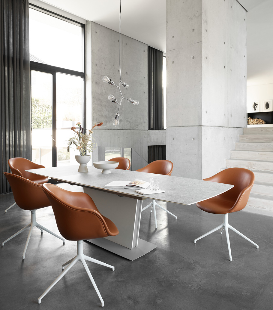 White Milano dining table with cognac leather chairs