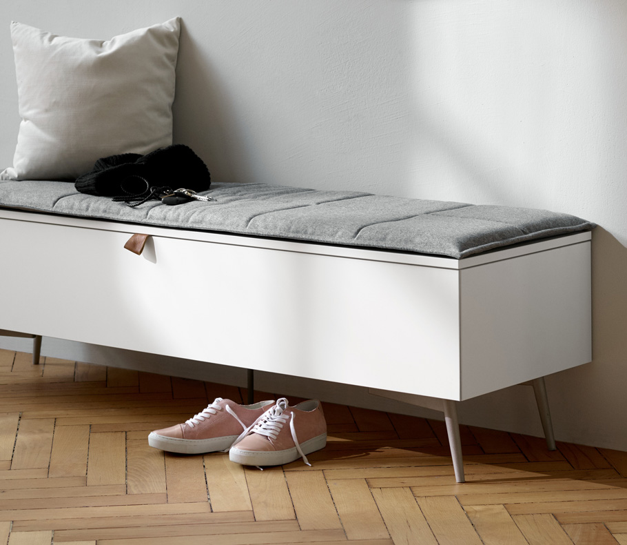 Laguno bench in white with storage and grey fabric seat