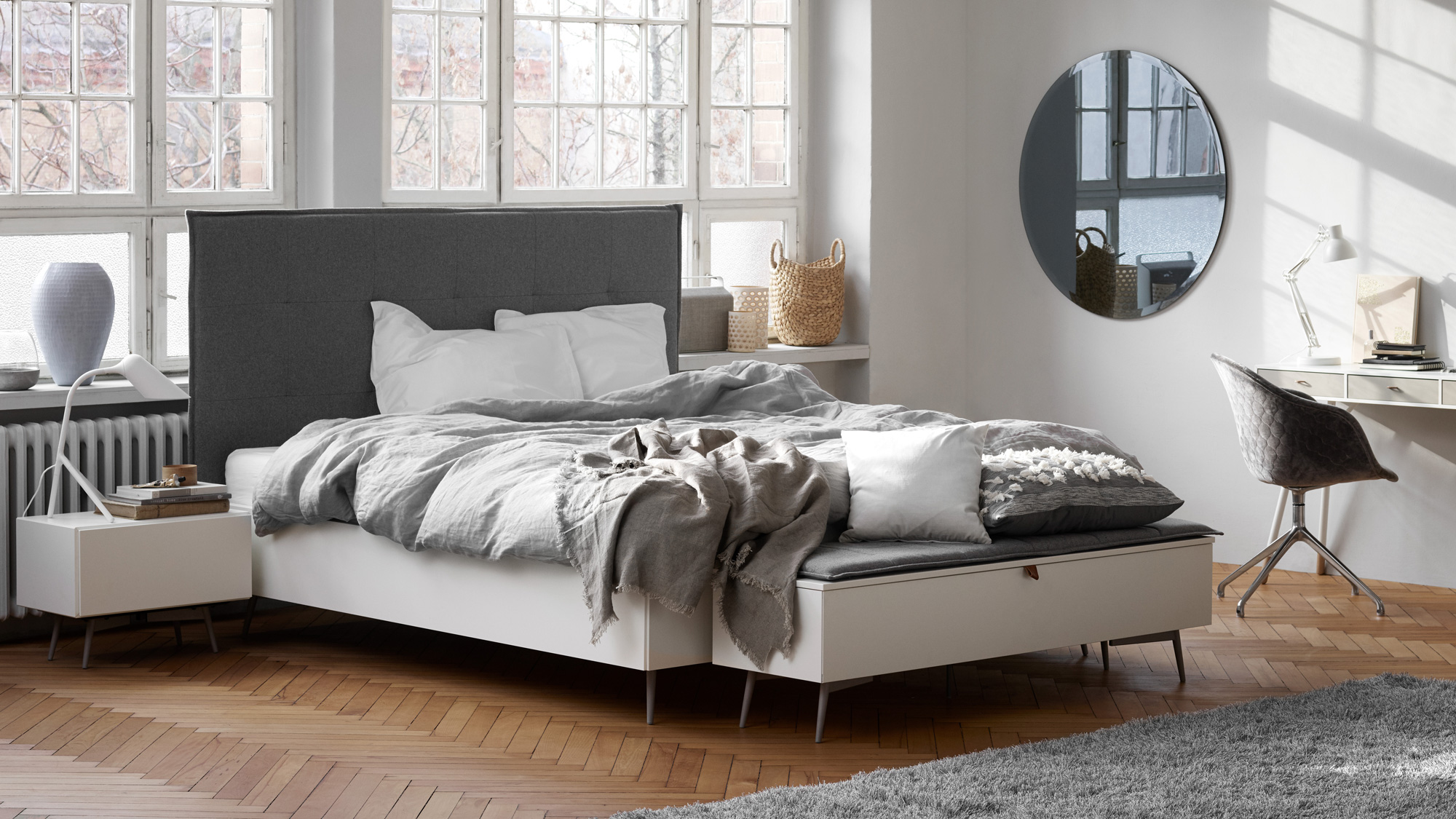 Laguno bed with grey headboard and dark grey bedspread and bench in white